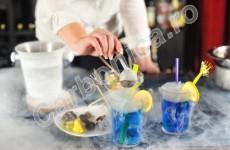 Lady bartender serving cocktails